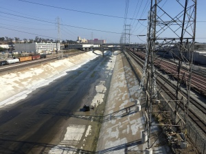 View of the LA River and surrounding industrial area from the bridge.